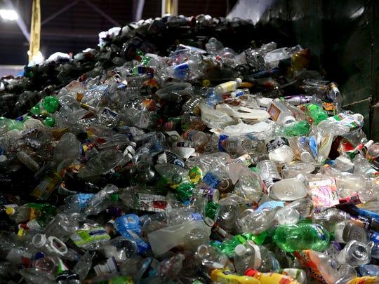 Plastic bottles are sorted at Garten Services in Salem on Thursday, Jan. 11, 2018.
