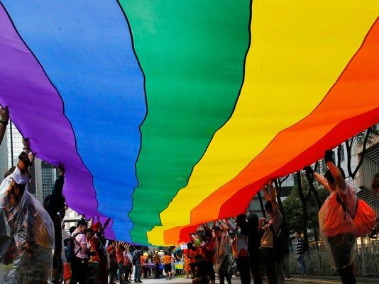 635913899529196311-gay-price-AP-Hong-Kong-Gay-Pride-Parad.jpg