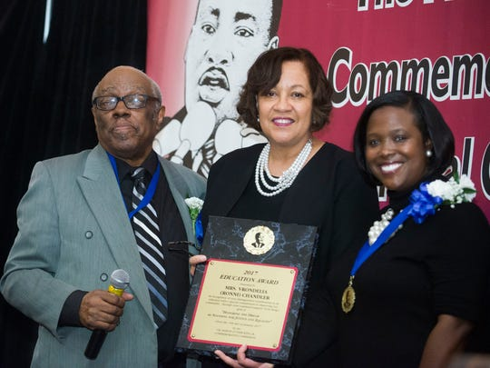 Education honoree Ronni Chandler, center, executive