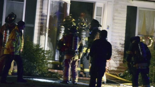 Emergency responders attend to a house fire that caused considerable damage to the home of Princeton Community High School athletic director Jason Engelbrecht.