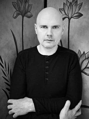 Smashing Pumpkins bandleader Billy Corgan has added the band's original drummer, Jimmy Chamberlin, to the lineup for a co-headlining tour with Marilyn Manson that begins July 7.