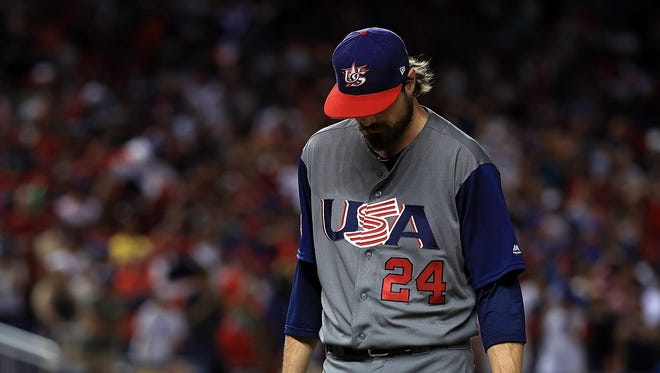 Andrew Miller gave up two home runs in the 8th inning to the Dominican Republic.