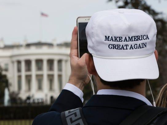 A man photographs the White House in Washington, Thursday,