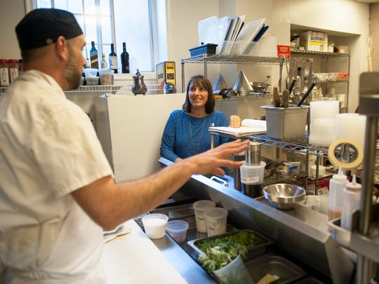 Naturalist Keara Giannotti and Phil Manganaro, chef/owner of Park Place Café & Restaurant in Merchantville discuss meal details prior to the restaurant's Forest To Fork dinner, a meal prepared with foraged ingredients.