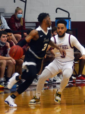 Bethel junior Tavughn Flowers defends York's Tyreece Berry during play Tuesday at Thresher Gym. Bethel plays Friday at Tabor.