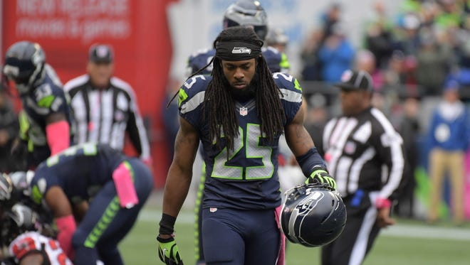 Seattle Seahawks cornerback Richard Sherman (25) reacts in the fourth quarter against the Atlanta Falcons during a NFL football game at CenturyLink Field. The Seahawks defeated the Falcons 26-24.