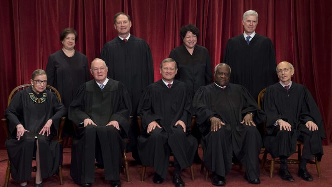 Justices of the Supreme Court sit for their official group photo last June, with Chief Justice John Roberts in the middle.