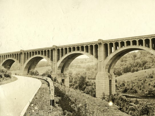 The arches form a beautiful vista, around 1920.