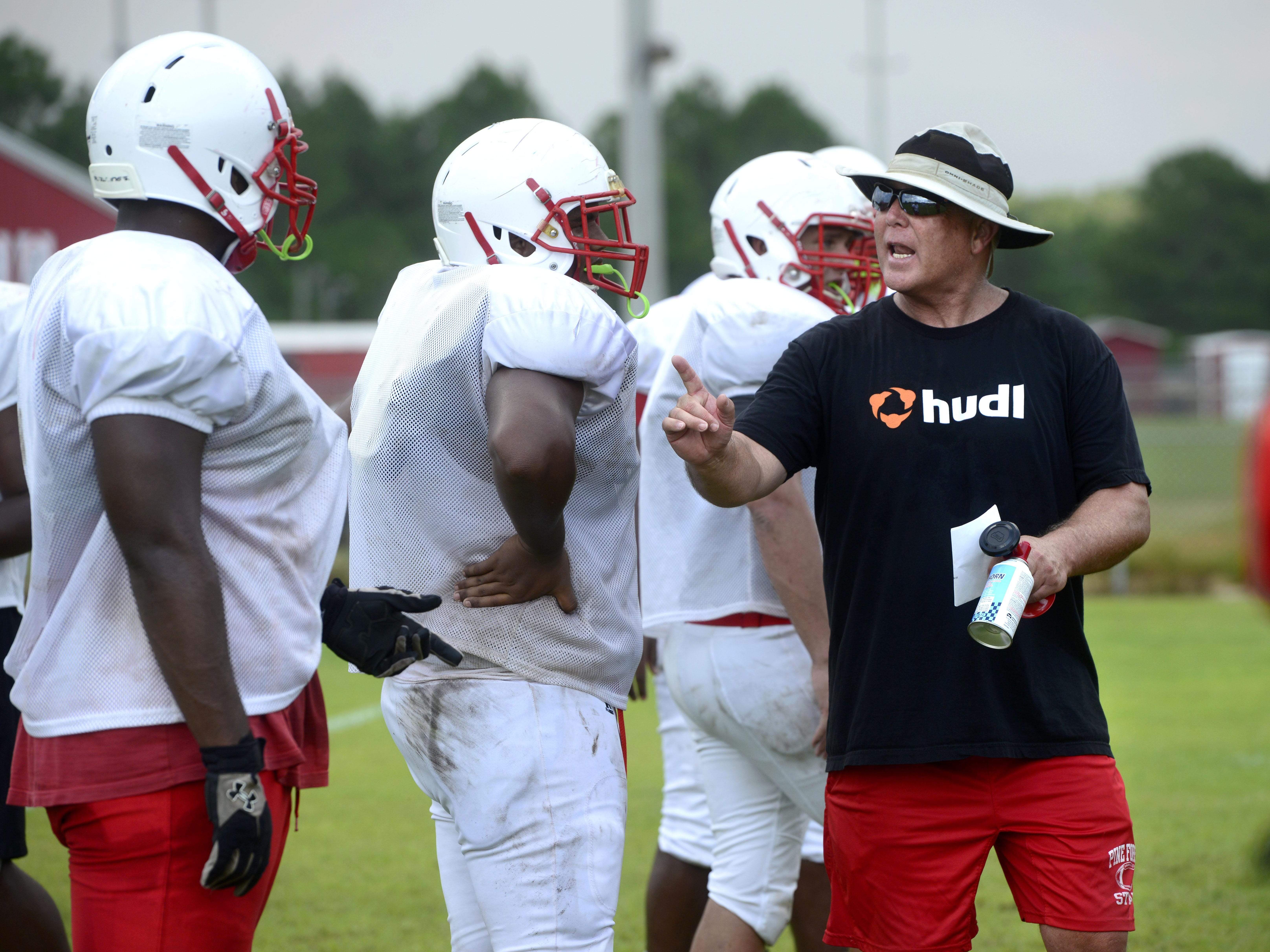 Artie Davis, interim head coach for Pine Forest High School, works with players Wednesday as they prepare for the fall. Davis is standing in for head coach Jerry Pollard as he recovers from bypass surgery.