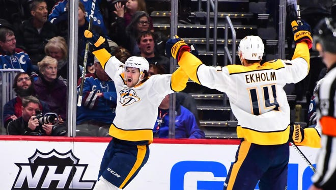 Mar 4, 2018: Nashville Predators left wing Filip Forsberg (9) celebrates his winning overtime goal with defenseman Mattias Ekholm (14) against the Colorado Avalanche at the Pepsi Center.