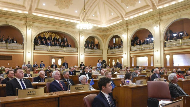 Lawmakers wait for the 2018 State of the State address in the South Dakota House of Representatives on Jan. 9, 2018 in Pierre, S.D.