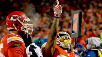 Kansas City Chiefs running back Charcandrick West (35) celebrates after scoring during the first half against the Oakland Raiders at Arrowhead Stadium.