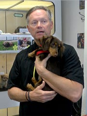 Bark Avenue Puppies owner Gary Hager is shown with