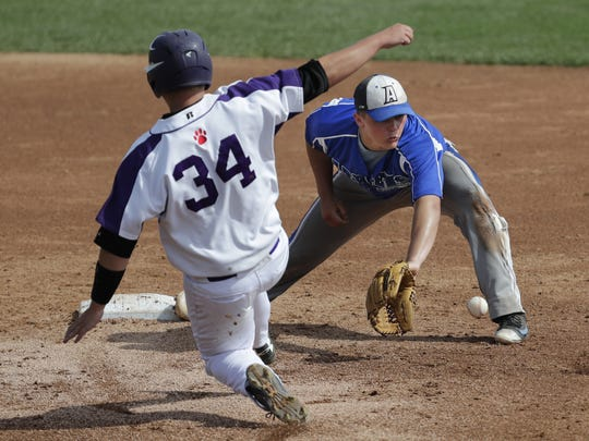 Athens High School's Marshall Westfallgets the tag against Independence/Gilmanton High School's Austin Johnson  during th WIAA Division 4 state championship game last Thursday in Grand Chute