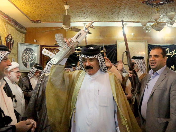 Iraqi Shiite tribal leaders chant slogans against the al-Qaeda-inspired Islamic State of Iraq and the Levant (ISIL) in Baghdad. The tribal leaders met in the Sadr City neighborhood of Baghdad, declaring their readiness to take up arms against the group.
