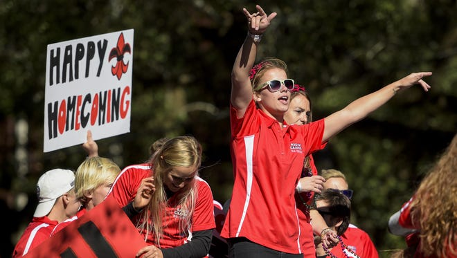 UL alumni and students ride in the 2014 UL Homecoming Parade in Lafayette, La., Saturday, Sept. 1, 2014. Paul Kieu, The Advertiser