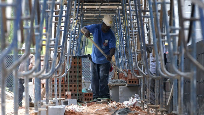 Laborers from Rippee Construction Co. work on Hawks Rise Elementary School on Thursday July 9, 2015 where a new building consisting of eight classrooms is being constructed and additions are being put on the cafeteria and kitchen.