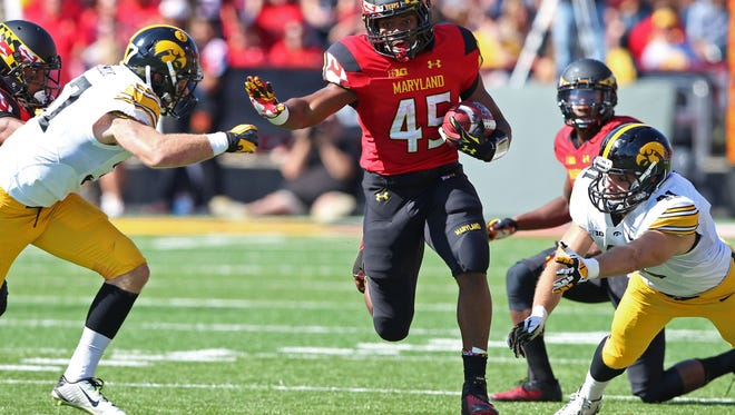 Oct 18, 2014; College Park, MD, USA; Maryland Terrapins running back Brandon Ross (45) runs up the middle against the Iowa Hawkeyes at Byrd Stadium. Mandatory Credit: Mitch Stringer-USA TODAY Sports