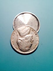 """This hollow nickel was created by an Iowa inventor and used as a prop in the new Tom Hanks thriller """"Bridge of Spies."""" The discovery of a similar coin in 1957 led to the arrest of Soviet spy Rudolf Abel."""