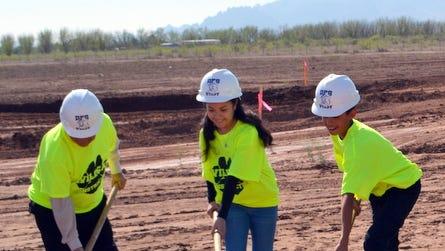 Breaking ground at the location of the new Deming Intermediate School are, from left, DIS Principal Lalo Mendoza and students Iliana Martinez, Alex Alfaro, Ivan Schultz, Diana Ortega and Teresa Martinez.