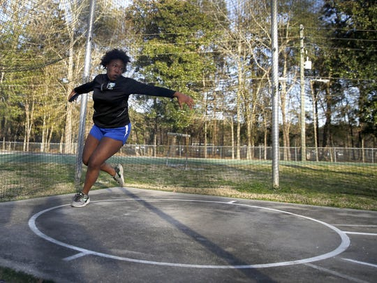 Dorian Solomon, a Godby junior and the defending 2A state champ in shot put, participates in the discus throw during the Jimmy Everett Invitational track meet at Lincoln High School on Wednesday.