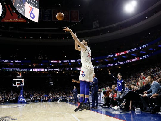 Philadelphia 76ers' Ben Simmons shoots a three-pointer during the first half of an NBA basketball game against the Cleveland Cavaliers, Saturday, Dec. 7, 2019, in Philadelphia. (AP Photo/Matt Slocum)