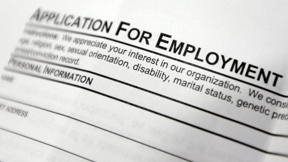 An employment application form on a table during a