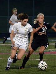 Howell's Ashley Strong (left), who scored the tying