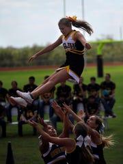 Santa Anna High School cheerleaders perform during a homecoming pep rally Oct. 6, 2017.