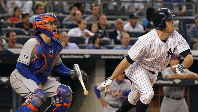Yankees left fielder Brett Gardner watches the flight of his second-inning grand slam Monday night. Mets catcher Travis d'Arnaud, left, homered in the fifth.
