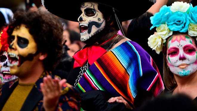 "People disguised as ""Catrina"" (Mexican representation of death) take part in the ""Catrinas Parade"" along Reforma Avenue, in Mexico City, Oct. 22, 2017."