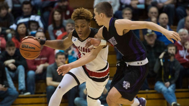 New Albany's Romeo Langford (1) drives the ball down court guarded by Bloomington South's Grayson Rolen (5) during the first round of the Class 4A regional at Seymour High School on Saturday, March 10, 2018. New Albany defeated Bloomington South 65-45.