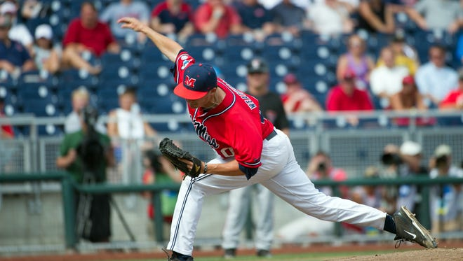 Mississippi Rebels pitcher Scott Weatherby (40) pitches in relief against the Texas Tech Red Raiders during game seven of the 2014 College World Series at TD Ameritrade Park Omaha.