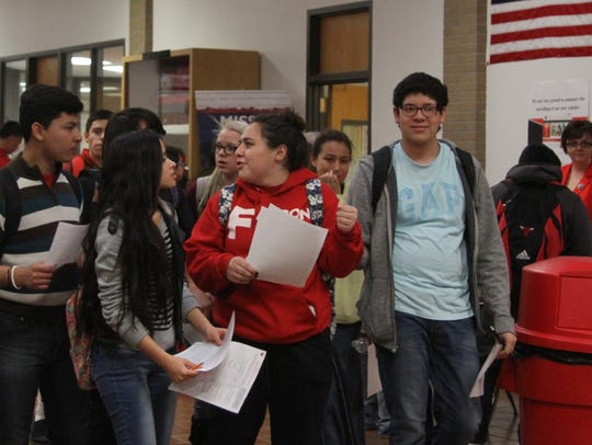 Students move between booths at Loving High School's