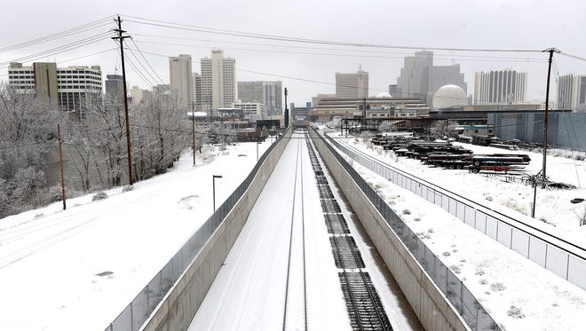 Fresh snow is seen in Reno from the Wells Avenue overpass on Jan. 12, 2017.