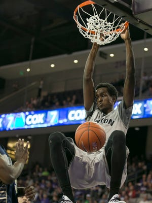 GCU's Kerwin Smith (13) dunks the ball against Montana State at Grand Canyon University in Phoenix, AZ on Nov. 17, 2014.