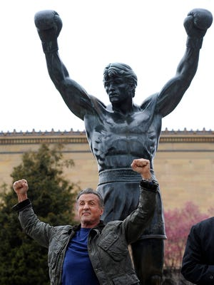 "Sylvester Stallone poses in front of the Rocky statue at the Philadelphia Art Museum at a photo op to promote ""Creed II"" in Philadelphia on Friday, April 6, 2018. The film, part of the ""Rocky"" film franchise, will be released later this year."