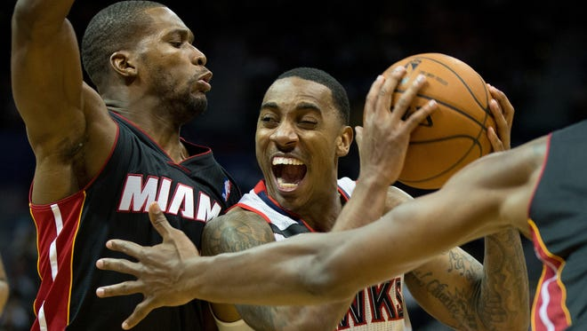 Atlanta Hawks guard Jeff Teague (0) is defended by Miami Heat guard Toney Douglas (0) during the fourth quarter at Philips Arena. The Hawks won 98-85.