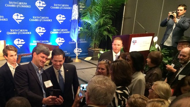Greenville businessman Blanton Phillips, second from left, takes a selfie with Florida Sen. Marco Rubio Thursday during the annual meeting of the South Carolina Chamber of Commerce on Hilton Head Island.