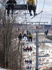 Skiers on the Visions Express chair at Greek Peak Mountain