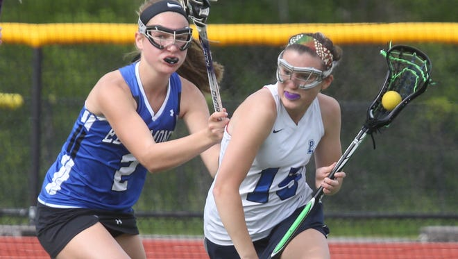 Putnam Valley's Stephanie Wagner is pressured by Edgemont's Emma Hoestray during their sectional outbracket game at Putnam Valley May 17, 2016. Putnam Valley won 15-6.