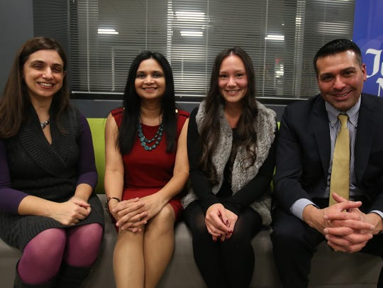 Panelist, Melissa B. Haber, left, Cleopatra Mack Scheublin, 3rd from left, and Michael J. Zarrilli, right, with The Journal News Engagement Editor, Swapna Venugopal Ramaswamy, 2nd from left, after The Spiel, an after-hours personal mixer in White Plains that focused on changing careers.