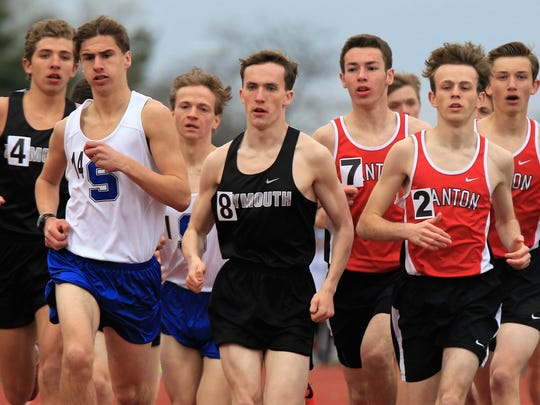 Plymouth, Canton and Salem runners compete during the