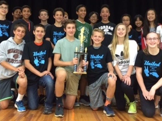 """Students on the Valley View Track Team participated in Pingry's Big Blue Relays.  Christopher Salkowski and Travis Jelmert are holding the First Place trophy won by the boys' team."""""""