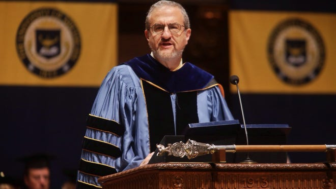 University of Michigan's 14th President Dr. Mark Schlissel speaks to the crowd on Friday, Sept. 5, 2014, as he takes on his new roll during his inauguration ceremony at Hill Auditorium at the University of Michigan.