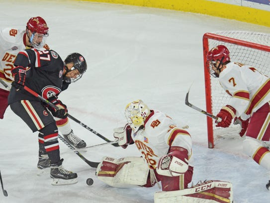 St. Cloud State's Blake Lizotte (27) goes after a loose