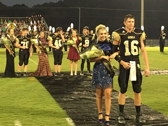 Senior Attendant Curstin Wallace and her escort Josh MacDonald participate in pre-game homecoming activities.