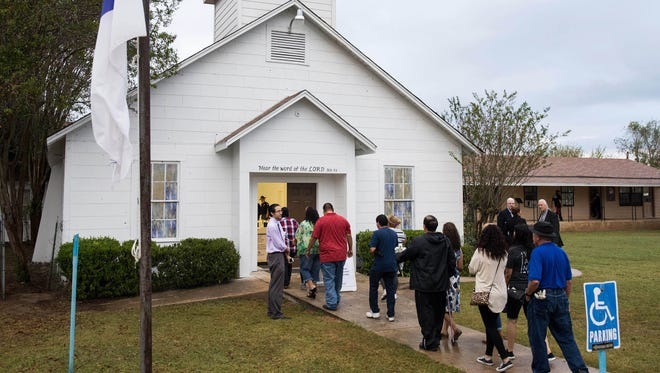 Members of the community wait in line to visit the memorial inside the First Baptist Church of Sutherland Springs.