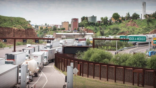 A long line of trucks waits to be checked by U.S. Customs and Border Protection officers at the Mariposa Port of Entry in Nogales, Arizona, on Aug. 9, 2017.
