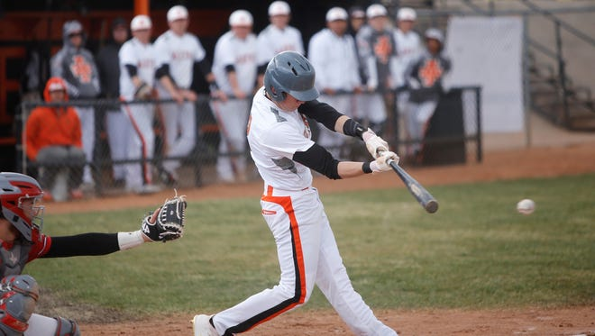 Aztec's Zack Taylor makes contact at the plate during Thursday's home opener against Durango. Visit daily-times.com for the latest scores, photo galleries and videos.
